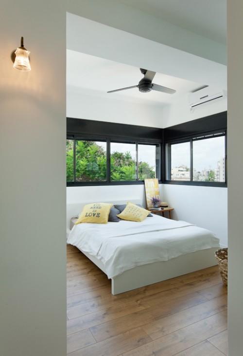 חדר השינה עוצב בקו עדין ומינימליסטי