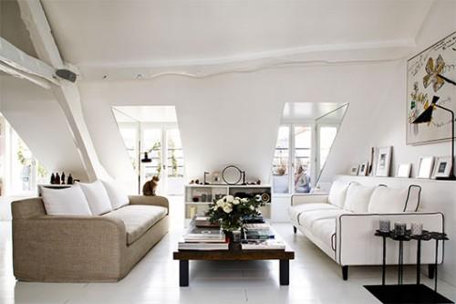 גוונים בהירים ושילובים של שחור ולבן הופכים את הסלון לנעים ואלגנטי | צילום: Francis Amiand